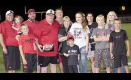 A FAMILY AFFAIR -- Harlan Community football coach Curt Bladt (holding ball) is joined by family members following Friday night's 17-14 victory at Glenwood. Bladt became just the third coach in Iowa prep history to reach 400 career wins. Left-right: HCHS assistant coach Todd Bladt (holding daughter Carson), Drew Bladt, Jeff Bladt, Curt Bladt and wife Jill Bladt, Greg Bladt (in back), Connor Bladt, Hannah Bladt, Angela Bladt, Sam Bladt, Shilo Bladt and Alex Bladt.