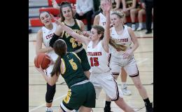 HCHS senior Ashley Hall (15) guards St. Albert's Allie Petry (5) near the basket during the Cyclones' 72-57 win. Hall scored a career-high 22 points in the game while Petry led St. Albert with 24. Also pictured in the lane are Brecken Van Baale (right), Macie Leinen and Claire Schmitz (left) of HCHS, along with Lauren Williams of St. Albert.
