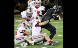 Harlan Community senior Allen Fries (17) wraps up Glenwood quarterback Zach Carr for one of his 10 sacks during the 2019 season. Fries was named first team All-State by the Iowa Print Sports Writers Association. Also pictured for the Cyclones are Joey Moser (23), Eli Monson (9) and Brenden Bartley (25).