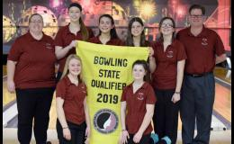 The HCHS girls bowling team and coaches with their 2019 state qualifier banner. Front row, L-R: Sydney O'Neill, Ania Kaster. Back row, L-R: Assistant coach Jami Andersen, Olivia Petersen, Jayden Gessert, Abby Swank, Madison Horn, head coach David Tyrrel. (Photo contributed)