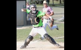 HCHS catcher Nick Tarney throws the ball to first base after forcing out Glenwood's Nathan Nebel at the plate during game one of Thursday's doubleheader.