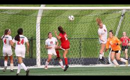 HCHS senior Kara Weis (8) tries to deflect a Treynor corner kick intended for Alyssa Kellar (12) during Friday's 1A regional semifinal. The ball sailed past the goal and was cleared by the Cyclones, who lost 5-0 and finished 10-8. Also pictured for HCHS: Ashley Sonderman (4), Megan Klein (24), Madison Parman (18) and goalie Lexi Musich (5).