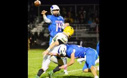 AHSTW quarterback Kyle Sternberg gets a throw off before a St. Albert player meets him in the backfield  (Photos by Bob Bjoin)