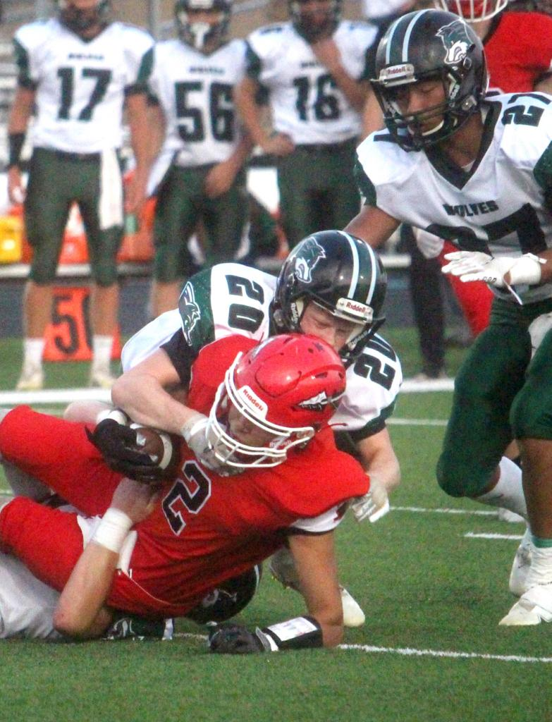 Missouri Valley's Alexis Manzo (2) is tackled by IKM-Manning's Hunter Smith (20) and another IKM-M player. Also pictured is Cooper Irlmeier (27). (Photo courtesy of Matt Gengler, Missouri Valley Times)