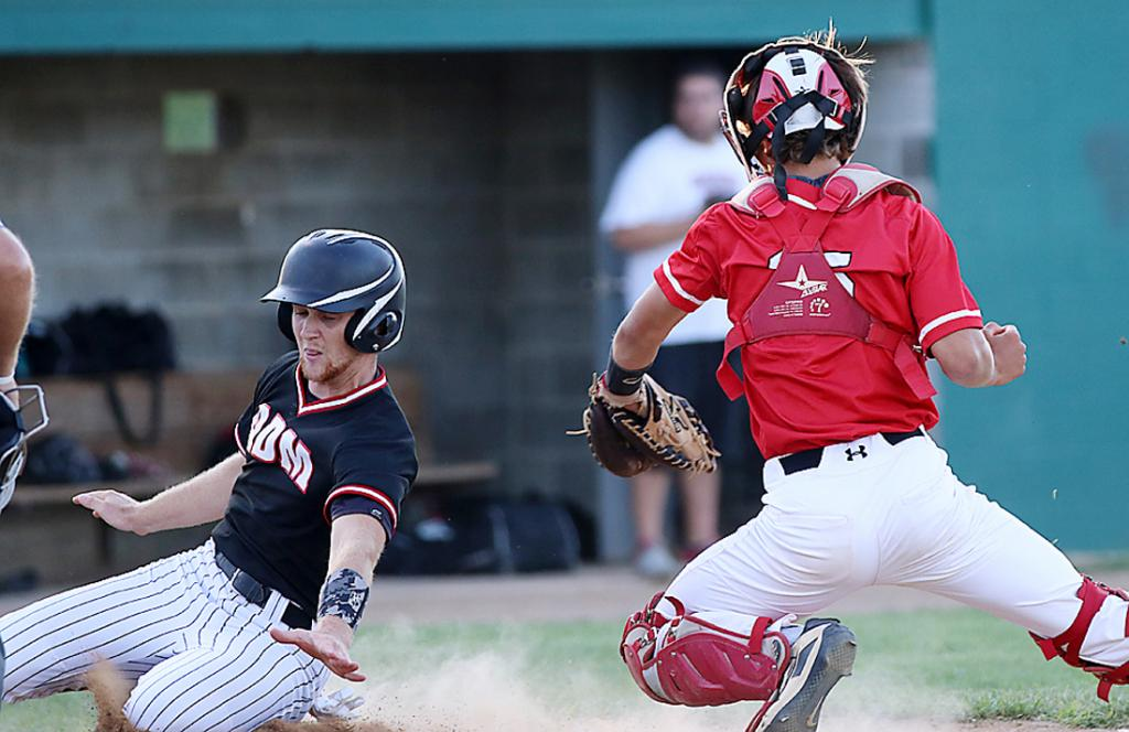 ADM's Zach Fuller slides around HCHS catcher Brenden Bartley to score the go-ahead run during the fourth inning Wednesday night. Fuller scored on Kaden Sutton's RBI single to put the Tigers up 2-1. They went on to win the 3A substate final 3-1. (Photos by Mike Oeffner)