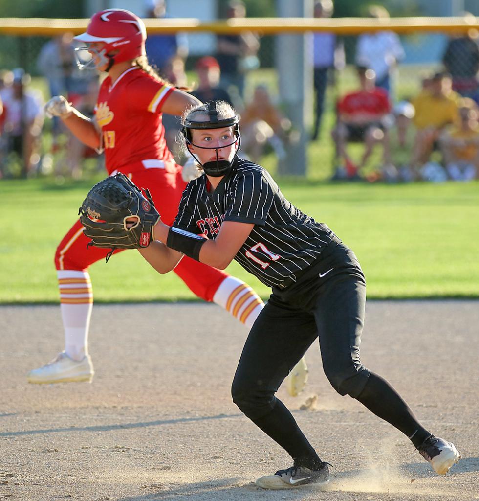 HCHS third baseman Aurora Miller looks to throw out a Carlisle runner at first.