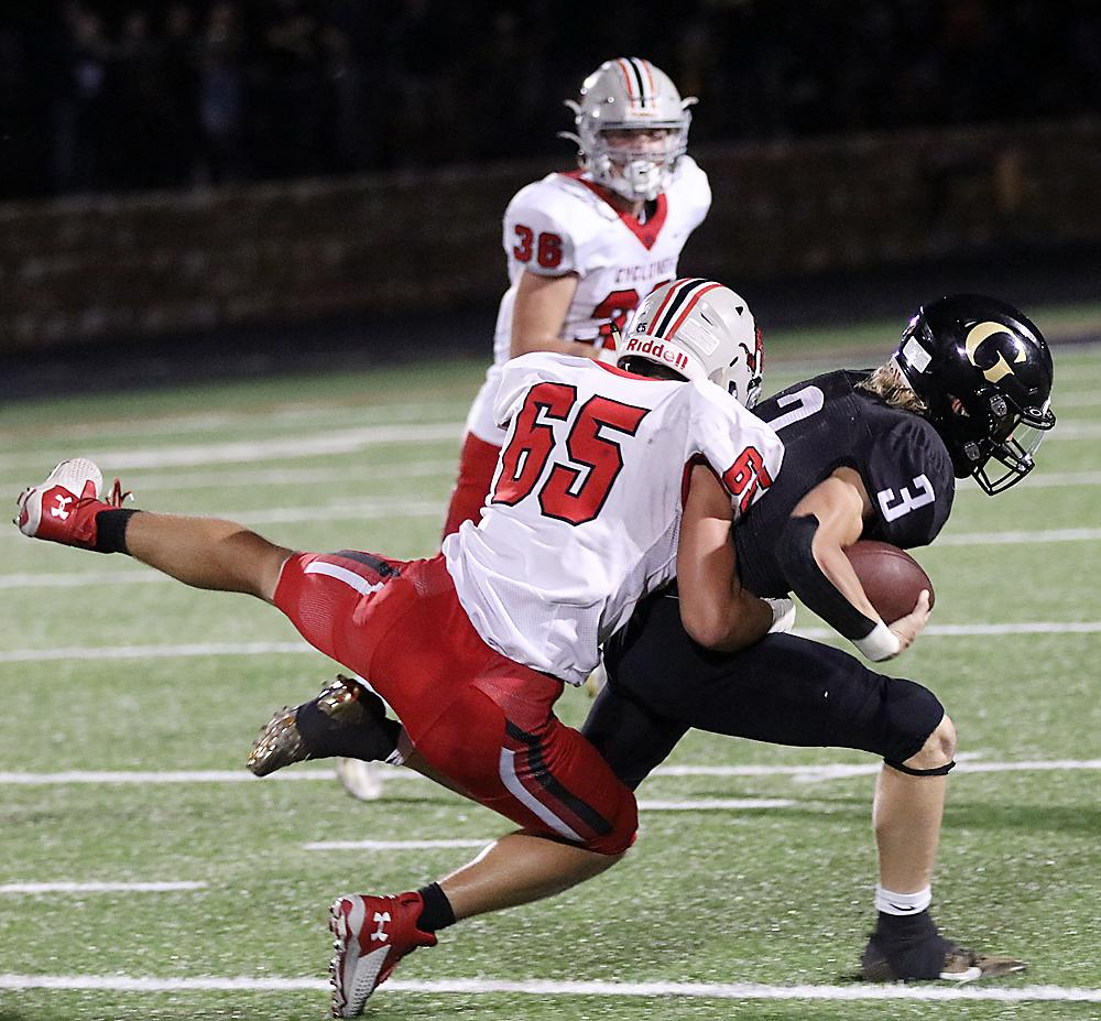 HCHS senior defensive end Alex Monson (65) catches up with Glenwood quarterback Tate Mayberry to make one of his seven tackles during Friday's Cyclone victory.