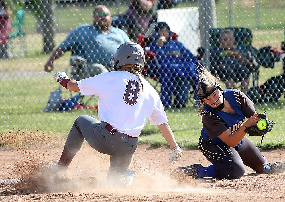 Alisa Partridge (8) slides safely into third base for Exira-EHK.