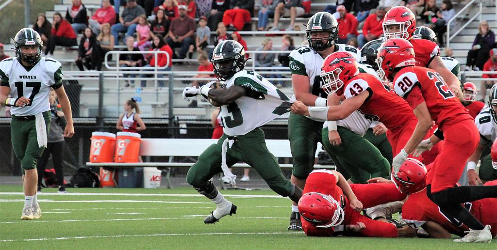 IKM-Manning's Amos Rasmussen (23) tries to break free from the grasp of Missouri Valley's Gage Clausen (43) during Friday's Class A, District 8 contest. Rasmussen scored three touchdowns on the night. (Photo courtesy of Brandi Perdew)