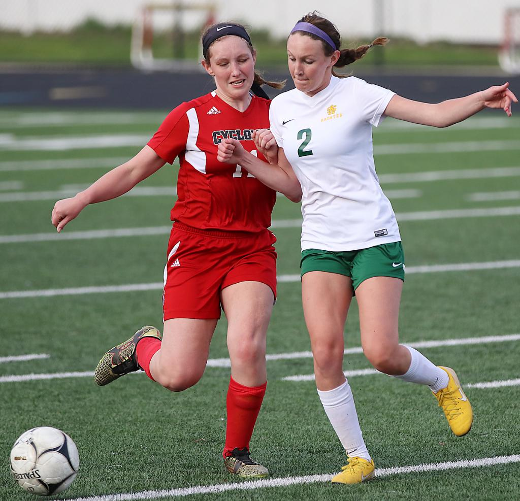 HCHS senior Dani Arkfeld (left) fights for possession of the ball against St. Albert. (Photos by Mike Oeffner)