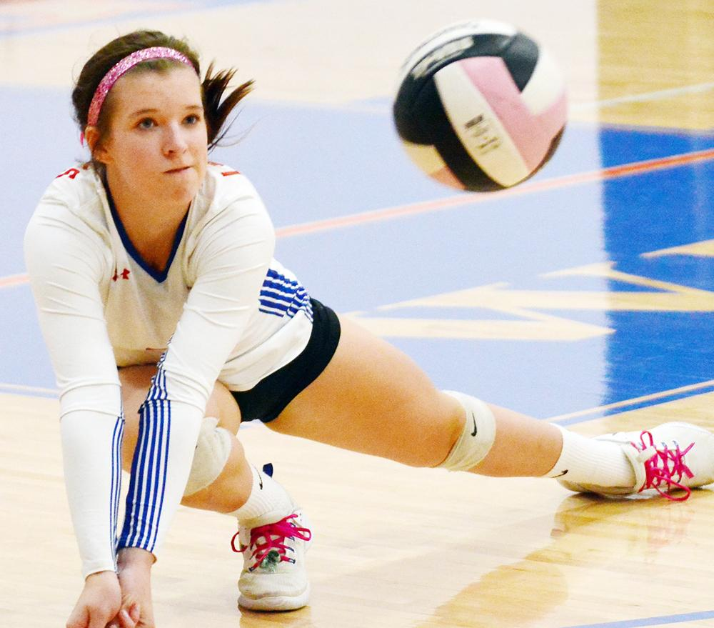 AHSTW senior Baylee Meyers makes a dig attempt during Tuesday's Western Iowa Conference match against Audubon. Meyers finished with nine digs.