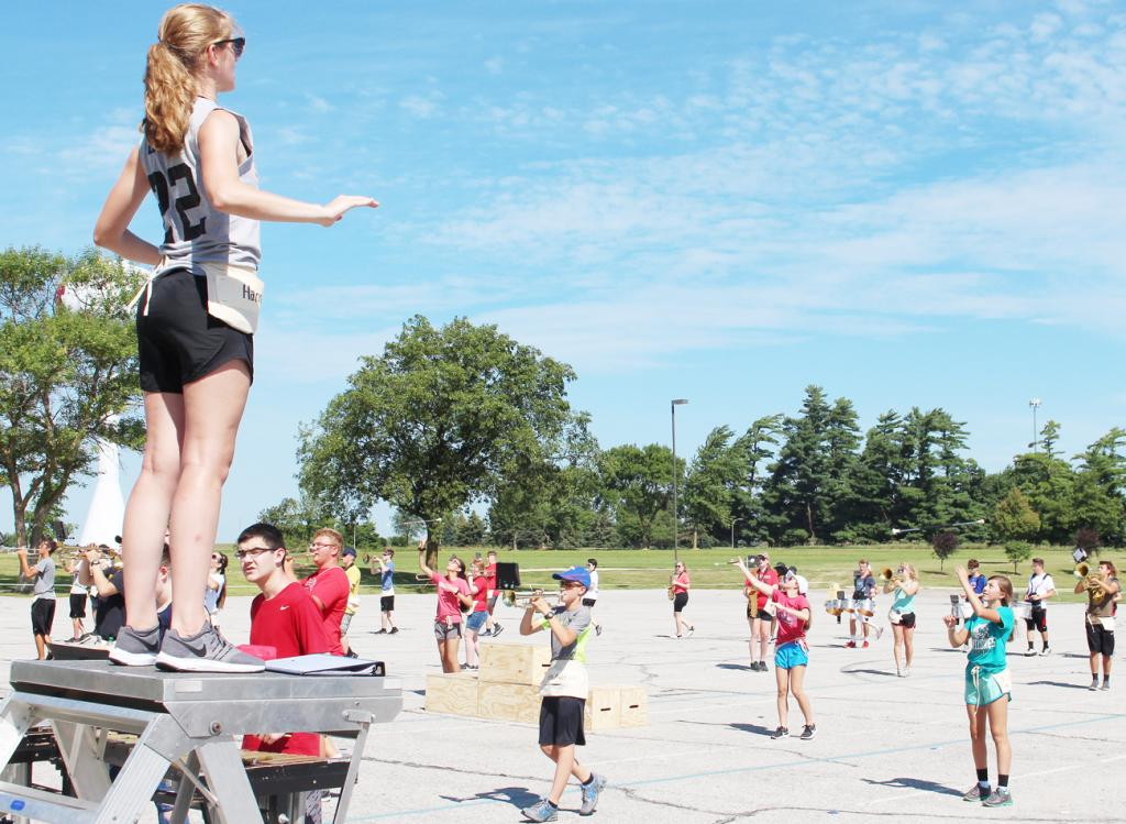 Students practiced outside working on their fundamentals, drills, footwork, songs, baton twirling and flag work. (Photo by Ryan Pattee)