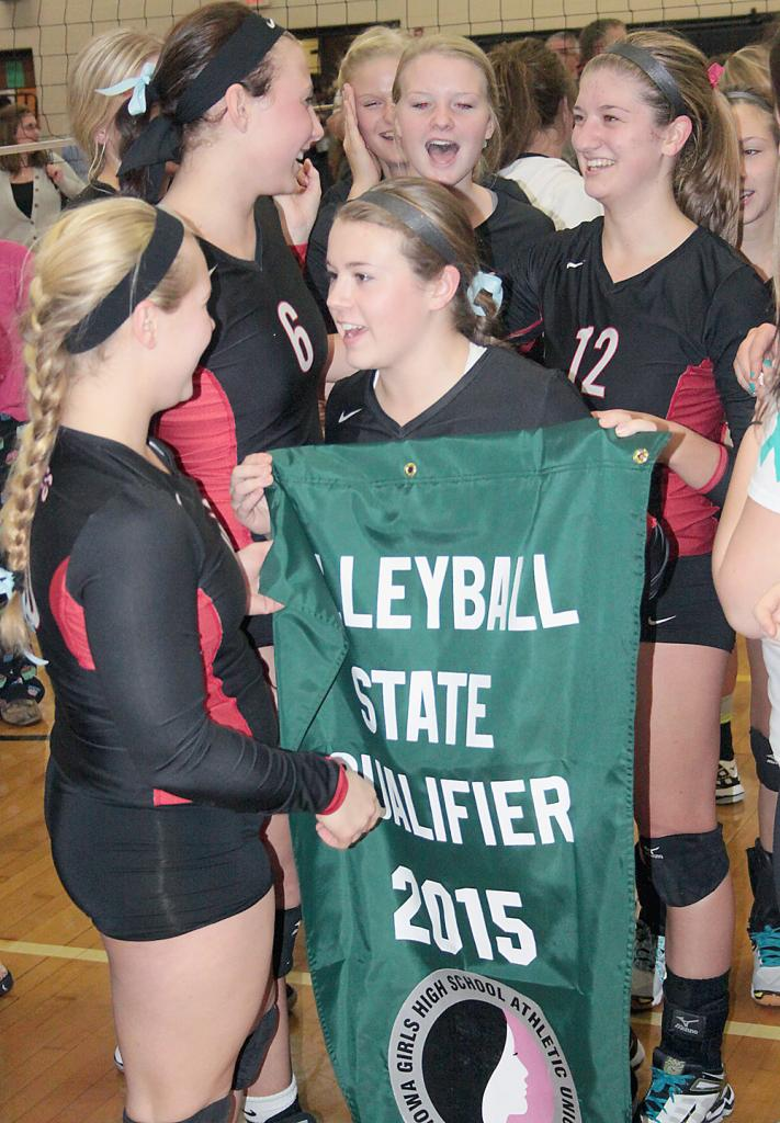 Cyclone players are all smiles following Tuesday's victory as Maggie McGrath and Julia Sorfonden hold the state qualifier banner.