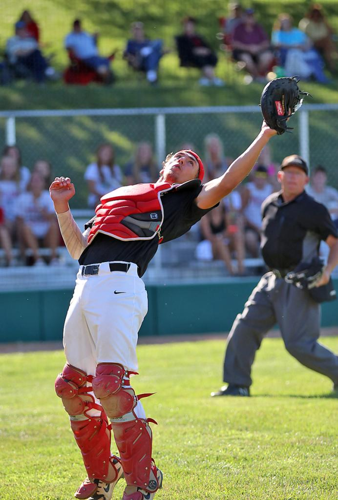 HCHS catcher Brenden Bartley reaches back to make a foul ball catch during the third inning of the Cyclones' 13-3 district final win over Denison-Schleswig.