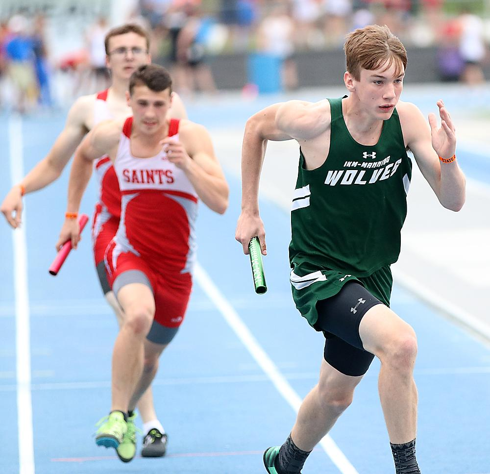 IKM-Manning senior Parker Behrens (right) competed in three state meet events last spring. Behrens anchored the Wolves to second place in the 4x800 relay. (Photos by Mike Oeffner)