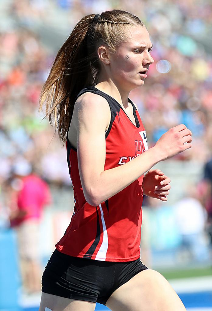 HCHS senior Lucy Borkowski earned a third-place medal in the 3,000-meter run at the Hawkeye Ten Conference Track Meet last May and later placed 16th in Class 3A at the state meet (above).