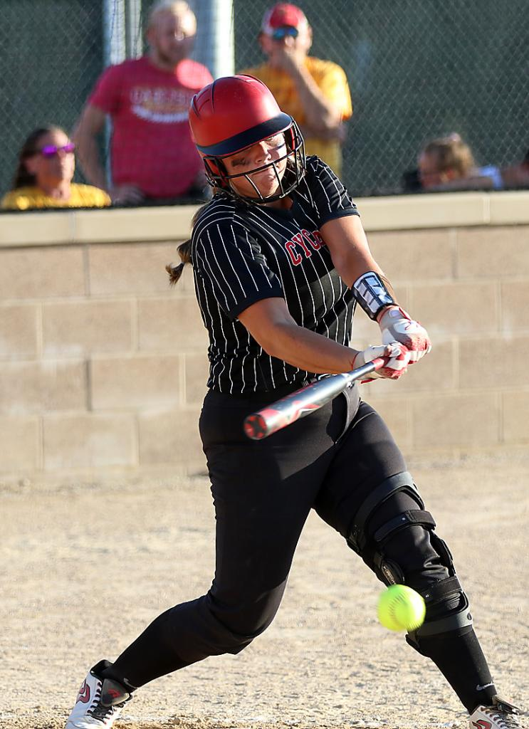 Cyclone junior Emily Brouse puts the ball in play during the second inning.