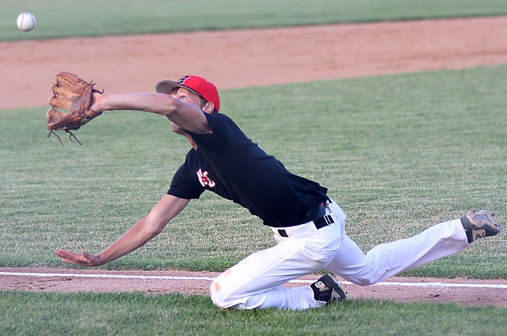 Harlan Community senior pitcher Connor Bruck makes a diving foul ball catch in the first inning of Wednesday's Class 3A substate final.