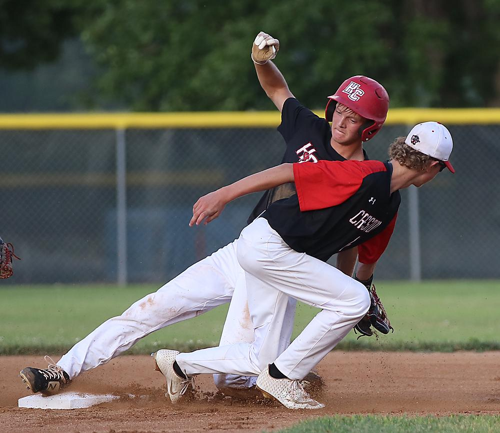 Cyclone senior Connor Bruck slides into second with a stolen base against Creston. Bruck had two hits, scored two runs and pitched six innings as HCHS advanced to the district finals.