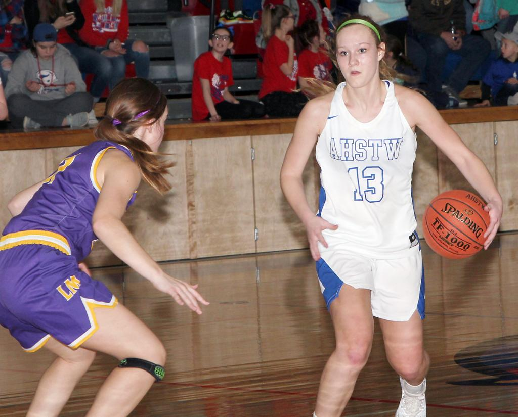 Junior guard Claire Harris (13) handles the ball for the Lady Vikes. (Photo by Kim Wegener)