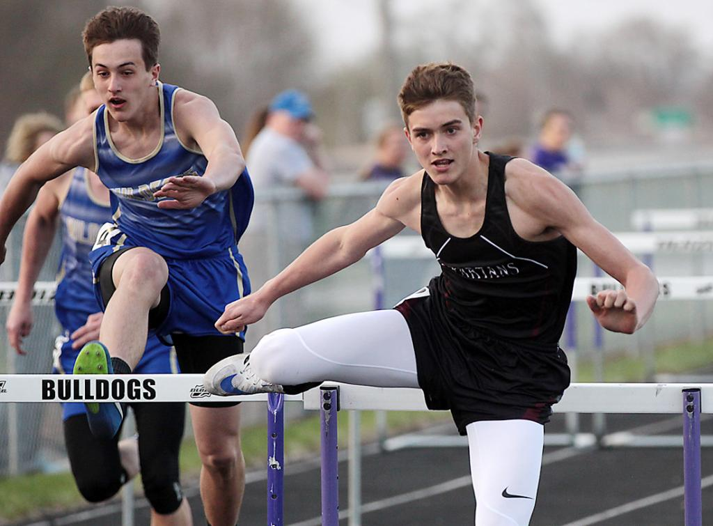 Exira-EHK's Creighton Nelson (right) competes in the 110-meter hurdles at the 2018 Rolling Valley Conference Meet. (Photo by Mike Oeffner)