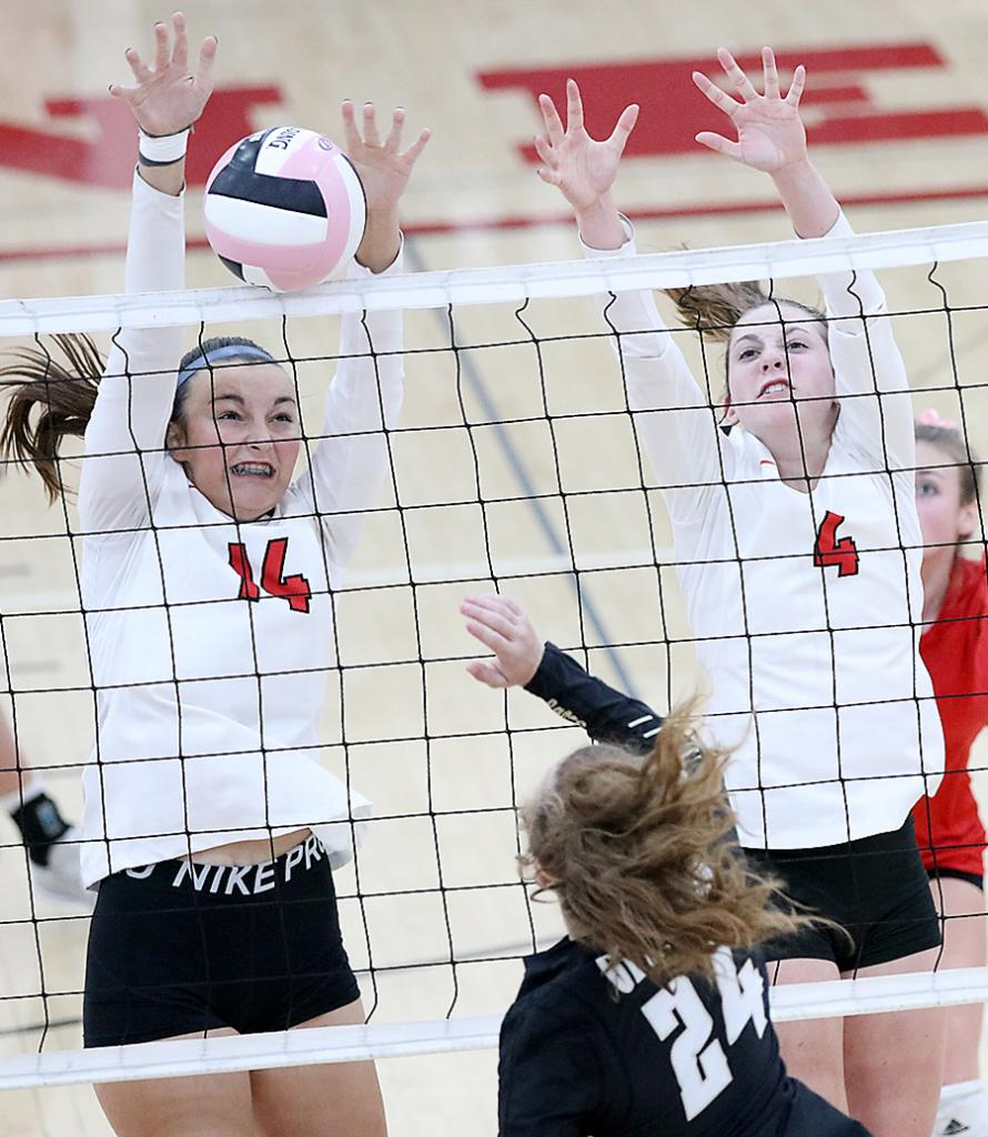 HCHS sophomores Claire Schmitz (14) and Zophi Hendricks (4) protect the net for a block against Glenwood's Coryl Matheny. The Cyclones lost to the Rams 3-1 Tuesday night and were also defeated in three sets by St. Albert. (Photos by Mike Oeffner)