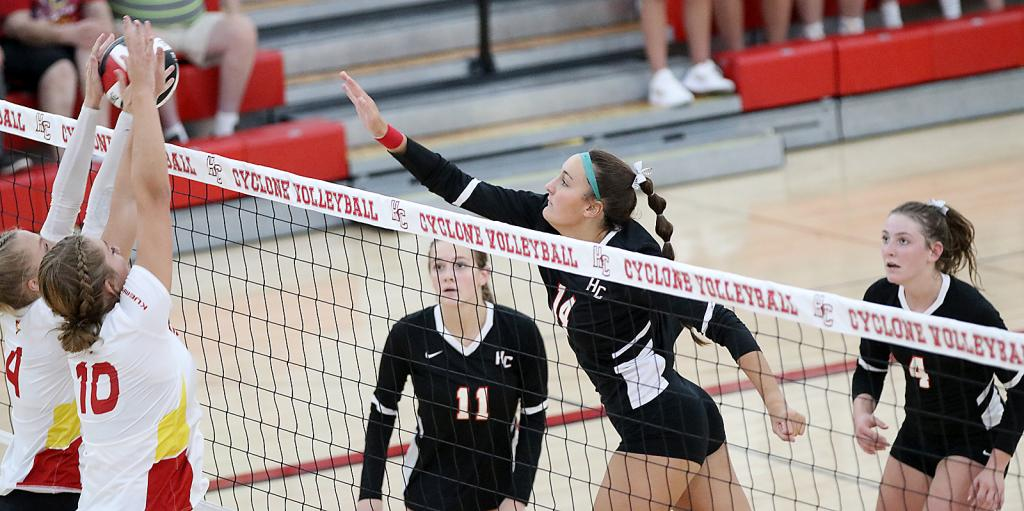 HCHS senior Claire Schmitz (14) attempts to hit through the block of Kuemper Catholic's Sophie Badding (10) and Kamryn Venner as Maci Schmitz (11) and Zophi Hendricks (4) look on during Tuesday's Hawkeye Ten volleyball match. The Cyclones were competitive in each set but lost to the Knights 25-22, 25-21, 25-18. (Photos by Mike Oeffner)
