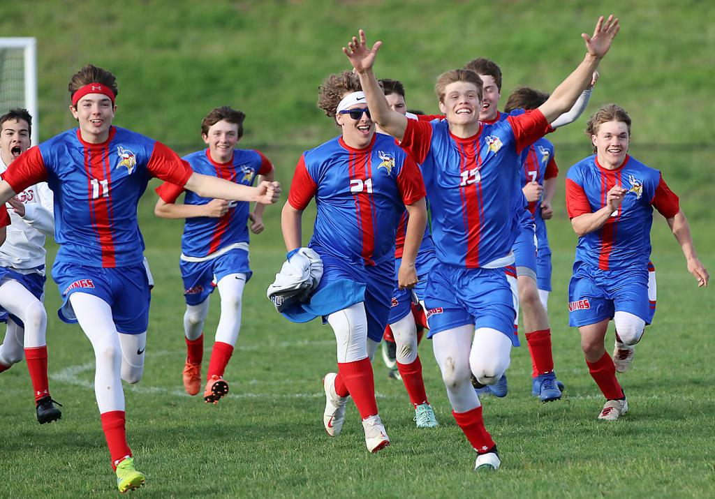 AHSTW's Raydden Grobe (11) and Clayton Akers (15) lead the celebratory charge toward goalie Lucas Young after the Vikings defeated Underwood in a penalty kick shootout in last year's Class 1A substate semifinals.