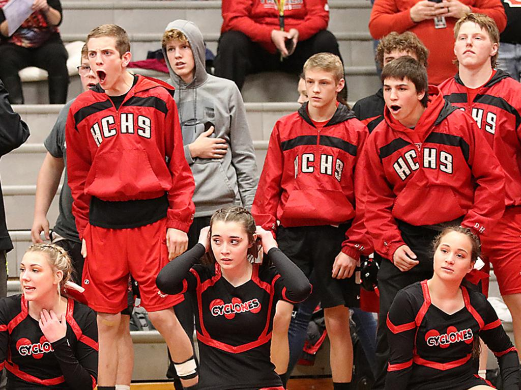 BARN BURNER -- There were many intense moments during Harlan Community's dual with Creston/O-M Tuesday night. Above, Cyclone wrestlers and cheerleaders look on during a particularly close match. The host Panthers won the final match to prevail 39-36.
