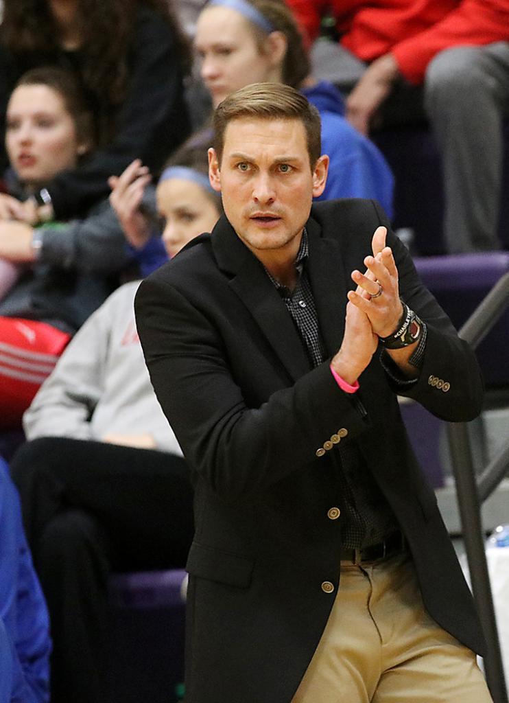 Viking head coach G.G. Harris encourages his team during the second half.