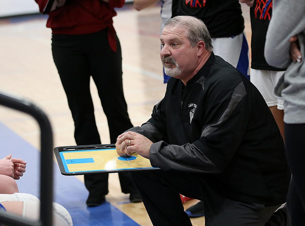 Former AHSTW girls basketball coach Steve Sauvain talks to his players in a timeout during the team's regional quarterfinal win against Underwood in February. Sauvain recently resigned as the AHSTW high school principal and girls basketball coach. He guided the Lady Vikes to a 35-11 record in two years, including the program's first WIC championship since 2001.
