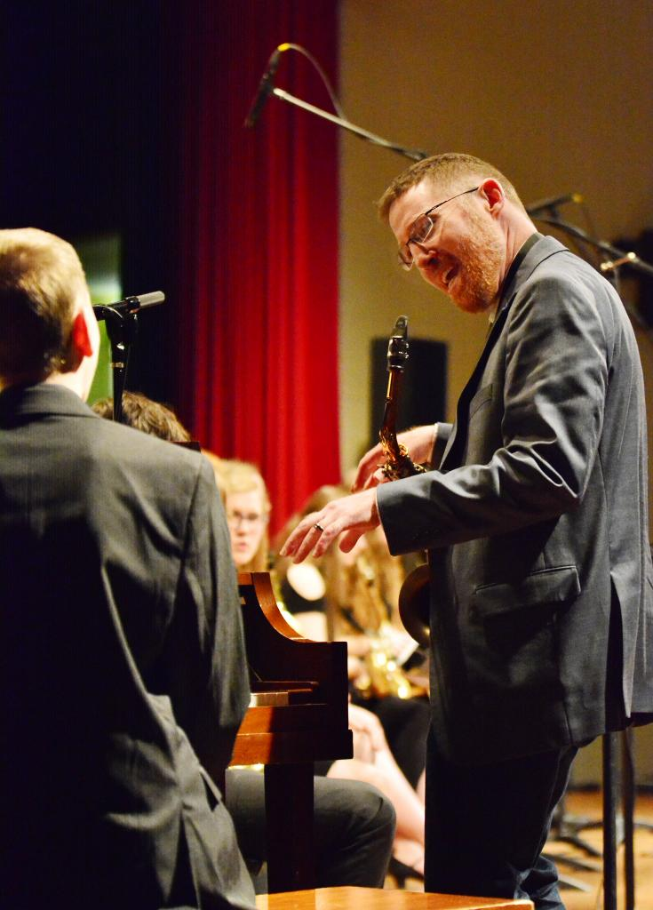 Pianist Timothy Conner gets some instruction from judge Tom Cronin, music instructor from the Harlan Community Schools.