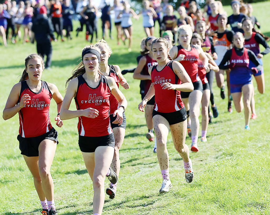 A pack of Harlan Community runners set the early pace at Saturday's Atlantic Cross Country Invite. HCHS girls, left to right, include: Kaia Bieker, Lucy Borkowski, Liv Freund (behind Borkowski), Abby Alberti, Brecken Van Baale and Abi Albertsen. Borkowski and Bieker both placed in the top five to lead the Cyclone girls to their sixth team title. (Photos by Mike Oeffner)