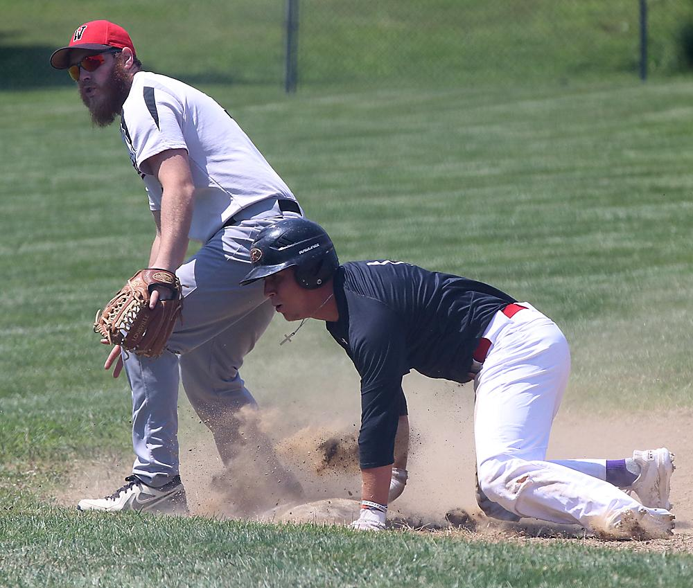 Portsmouth's Dillon Sears (right) is safe at third base as a throw gets by Walnut third baseman Pat Sachs during Sunday's contest.