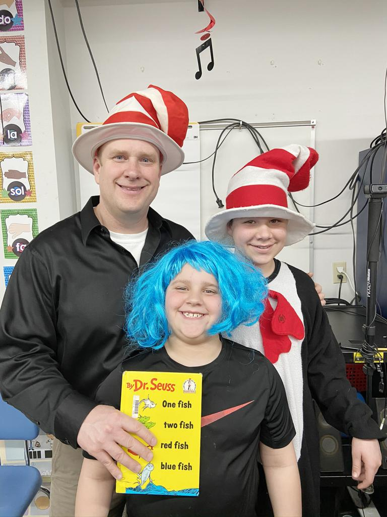 Dave Bauman was a guest reader at Literacy Night in March, pictured with his sons Jonah (front) and Manasseh.
