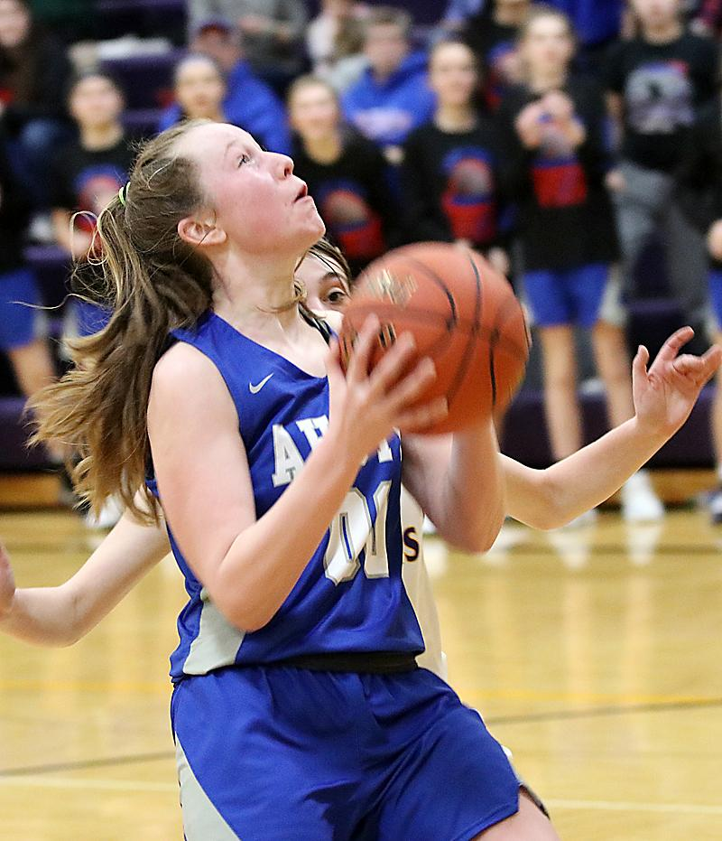 Lady Vike junior Claire Denning looks to score on a drive to the basket.