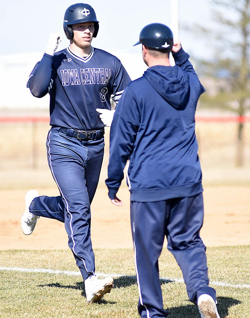 Ryan Doran is congratulated by Iowa Central coach Eric Stein (both are former HCHS players) after hitting one of his two home runs against Southwestern Community College on March 11. (Photo courtesy of Scott Vicker/SWCC)