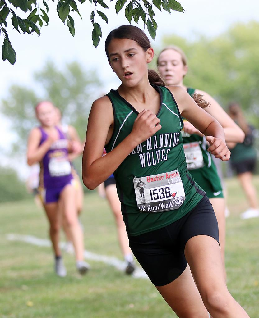 IKM-Manning freshman Emily Albertsen earned a 12th-place medal at Tuesday's AHSTW Cross Country Invite, helping the Wolves place third in the girls team standings. (Photos by Mike Oeffner)