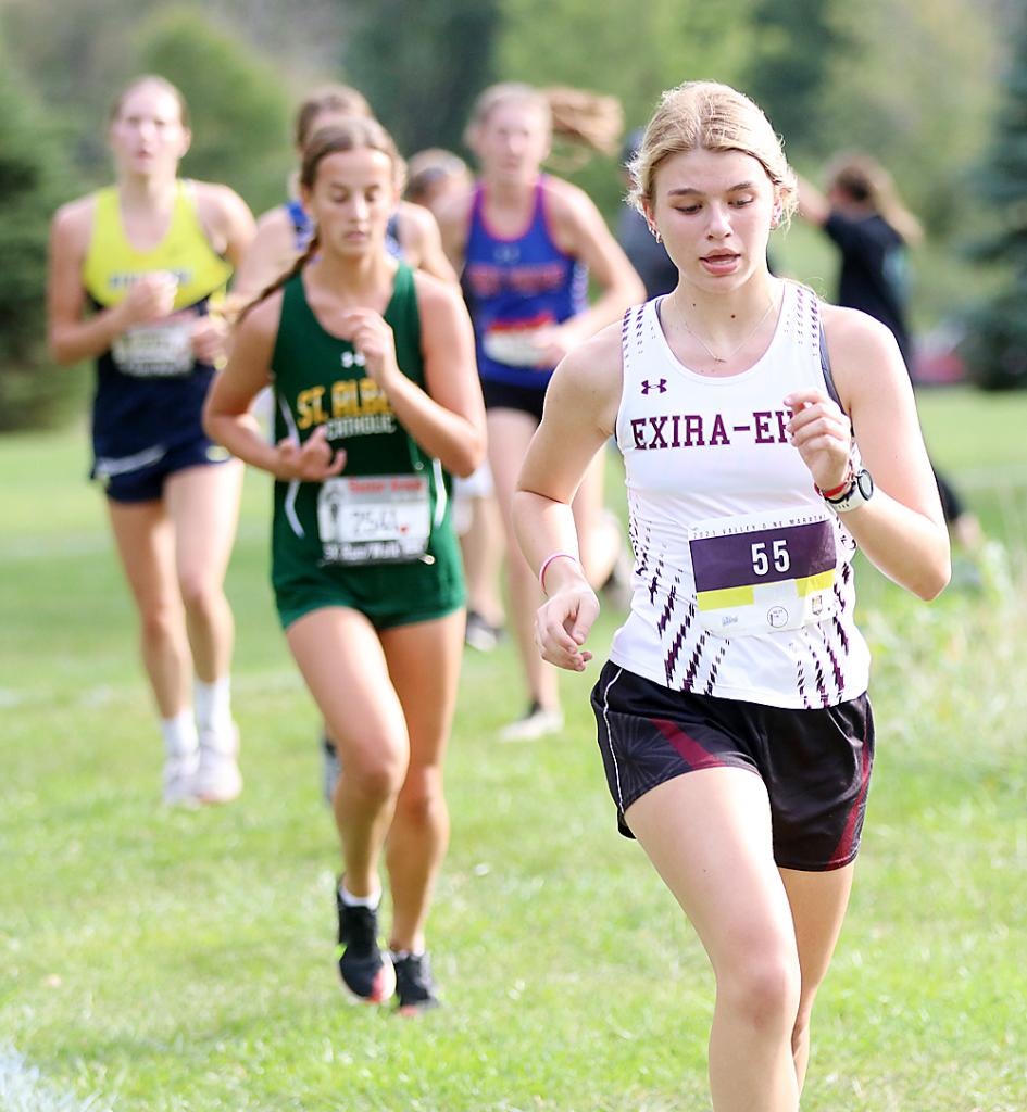Exira-Elk Horn-Kimballton junior Ella Petersen leads a pack of runners during the early stages of the AHSTW Invite in Avoca. Petersen placed 22nd to lead the Spartan girls.