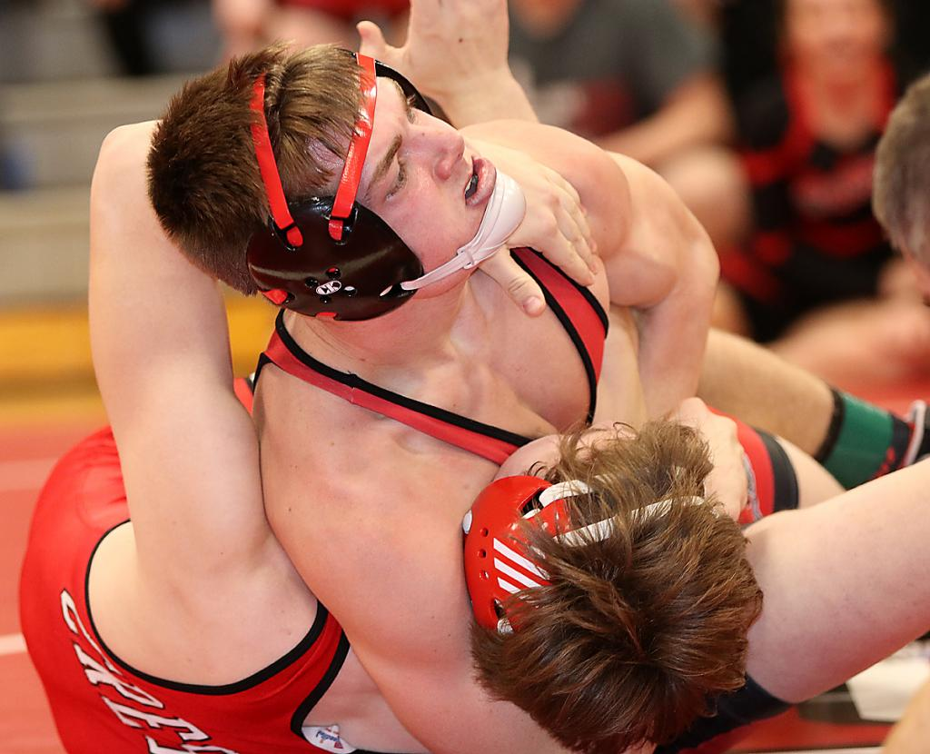 Cyclone senior Thomas Frederick cradles Austin Seaton of Creston in a 170-pound match. Seaton escaped at least two near-falls before Frederick finally pinned him with 18 seconds left to tie the dual at 36-36.