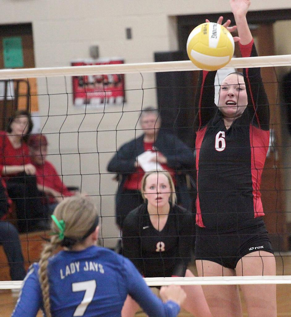 HCHS sophomore Haley Leinen (6) makes sure a Bondurant-Farrar attack stays on the Lady Jay side of the net.