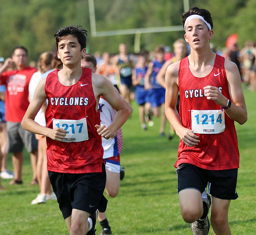 Keaton Heileson (right) and Jonathan Shelton of HCHS compete at the Lewis Central Invite. They finished 49th and 50th, respectively.