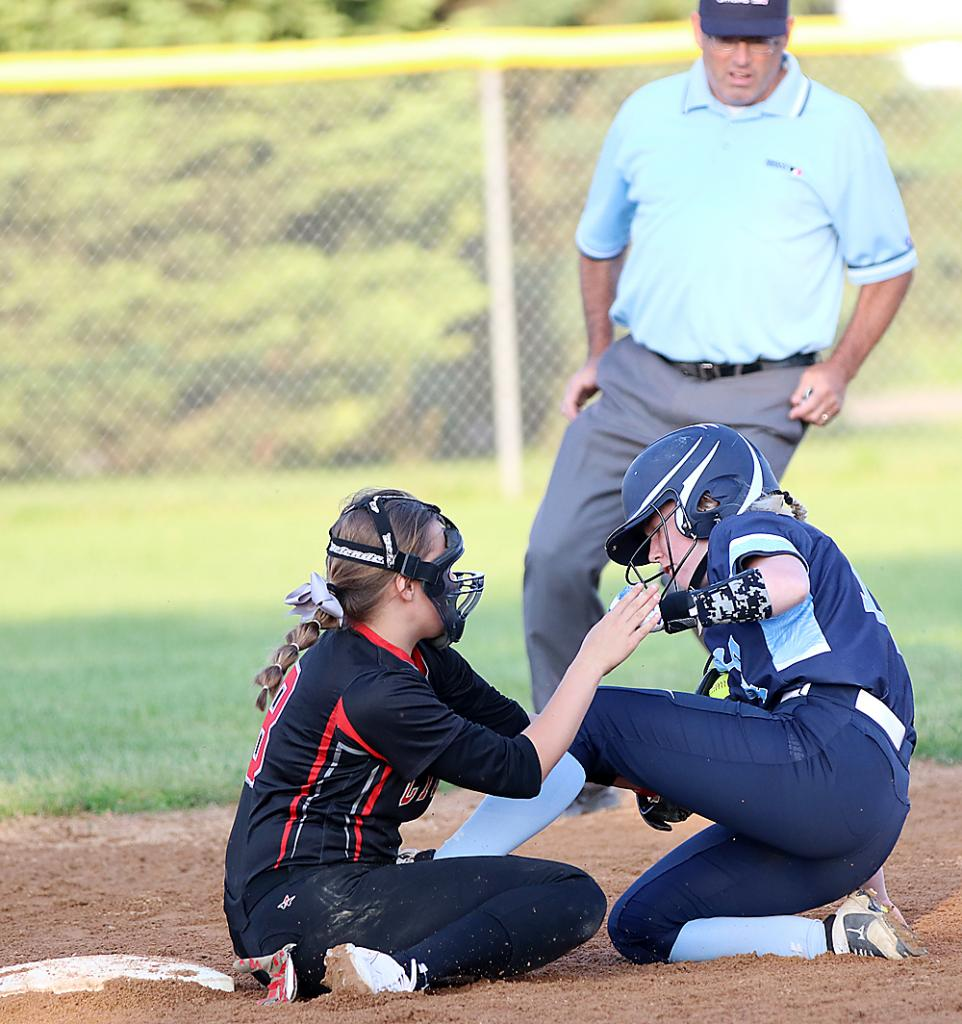 Harlan Community shortstop Kate Heithoff tags out a Lewis Central runner at second base during a home softball game in 2019.