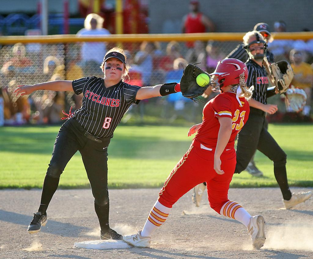 HCHS shortstop Kate Heithoff snags a throw as Carlisle's Kennedy Preston checks in safely at second base.