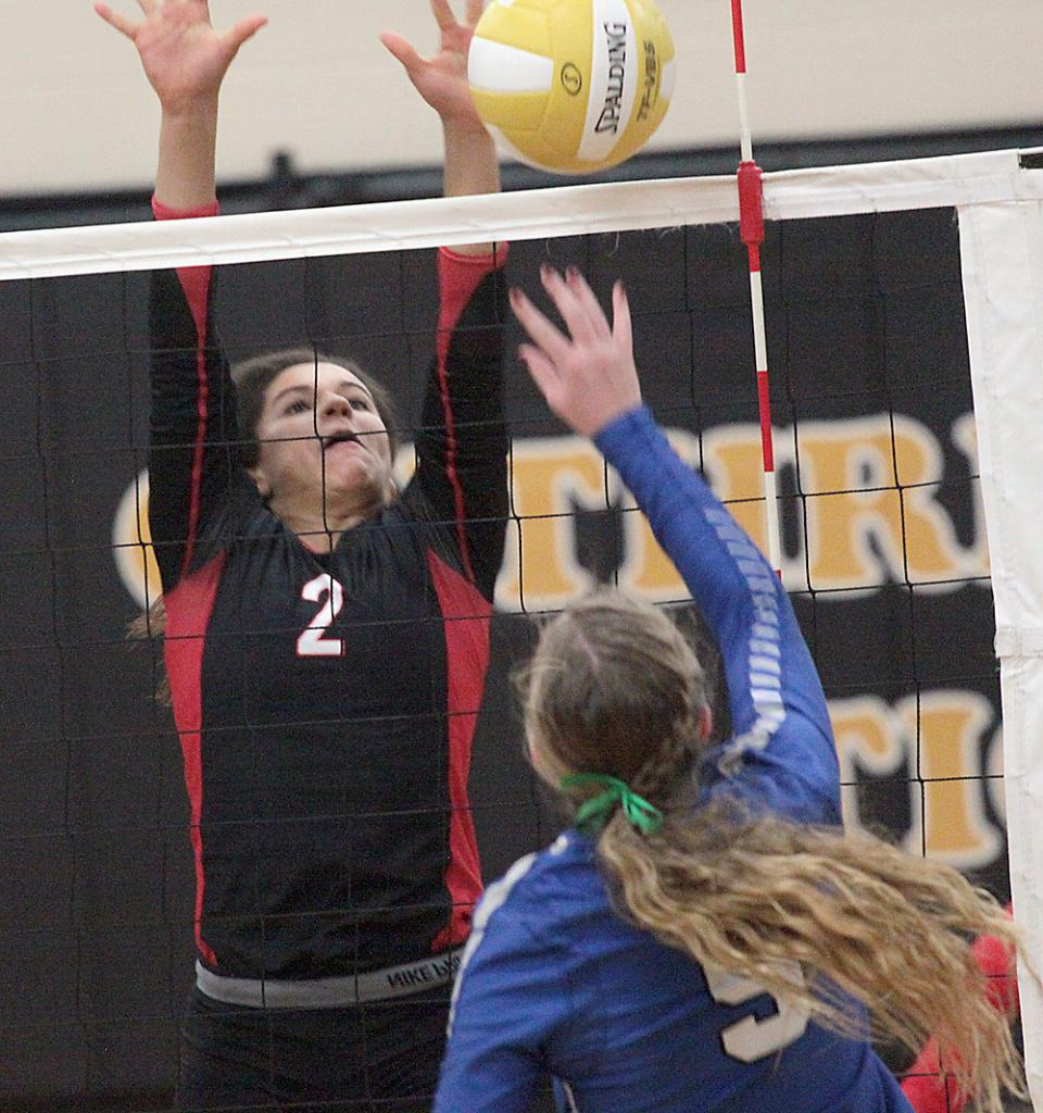 Harlan Community junior Brenda Hopkins (2) tries to block the attack of a Bondurant-Farrar player during last Tuesday's regional final sweep by the Cyclones.