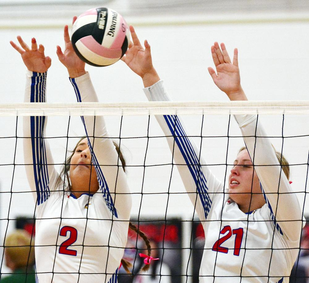 Saige Huss (21) and Kailey Jones combine for a Lady Vike block. (Photos by Bob Bjoin)