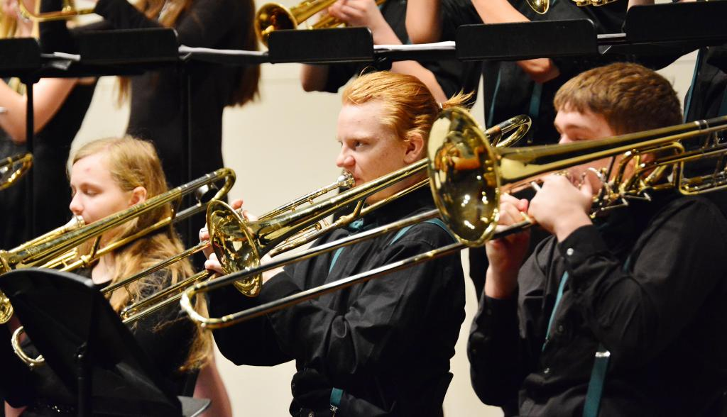 Trombonists L to R -- Avery Henkelman, Austyn Sweeney and Andan Spooner give it their all.