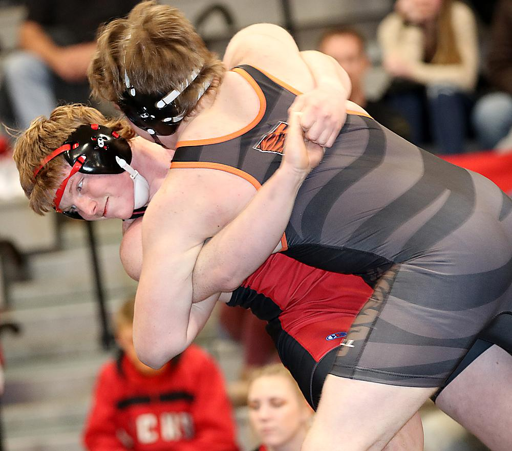 Cyclone junior Jesse Schwery (left) looks to throw Carroll's Tyson Bordenaro in a 220-pound match. Schwery won by fall in 3:05.