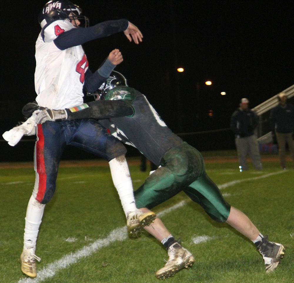 IKM-M senior Will Jorgensen (right) pressures Alta-Aurelia quarterback Logan McCoy during Friday's game. (Photo by Kim Wegener)