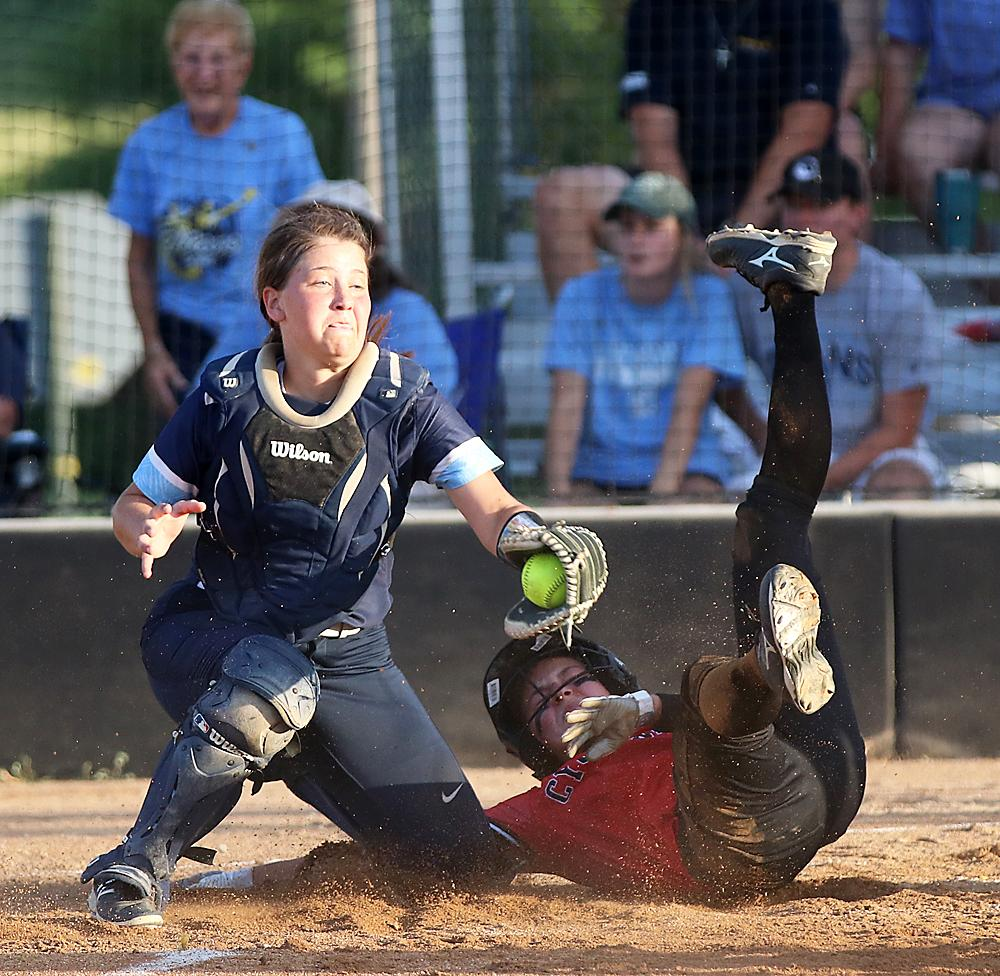 Cyclone junior Kennedy Kjergaard scores the game's first run in the bottom of the third before LC catcher Taylor Elam can apply the tag. HCHS prevailed 6-1.